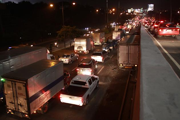 Seen around the area where the multi-vehicular accident happened involving 11 vehicles at the northbound lane of C5 road in Makati city, south of Manila on 09 November 2012. Reports stated that 1 moto