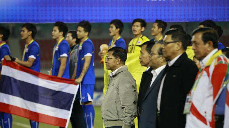 Hlaing stands during an awarding ceremony after Thailand beat Indoneisa in their men's final soccer match at 27th SEA Games in Naypyitaw