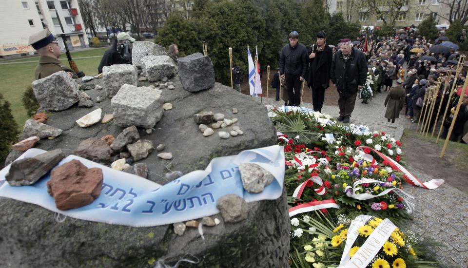Members of Warsaw's Jewish community, with  city officials and others gather to mark the 69th anniversary of the doomed Warsaw Ghetto Uprising, in Warsaw, Poland, on Thursday, April 19, 2012. (AP Photo/Czarek Sokolowski)