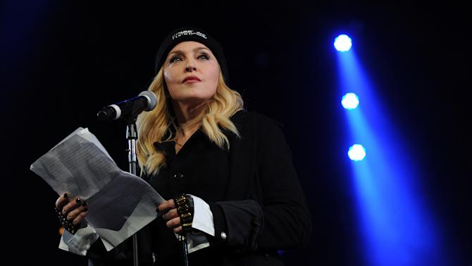 "Madonna participates in Amnesty International's ""Bringing Human Rights Home"" Concert at the Barclays Center on Wednesday, Feb. 5, 2014 in New York. (Photo by Evan Agostini/Invision/AP)"