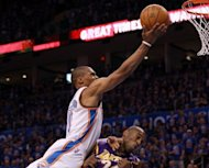 Oklahoma City Thunder&#39;s Russell Westbrook shoots over Los Angeles Lakers&#39; Kobe Bryant during game five of their NBA Western Conference series on May 21. Oklahoma City eliminated the Lakers in five games with a dominating 106-90 victory night