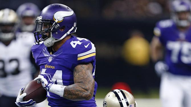 Minnesota Vikings running back Matt Asiata (44) carries past New Orleans Saints free safety Rafael Bush (25) in the first half of an NFL football game in New Orleans, Sunday, Sept. 21, 2014. (AP Photo/Rogelio Solis)