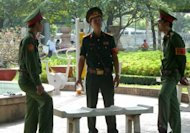 Three soldiers guard at a public park next to the Ho Chi Minh City People&#39;s Court on August 10, 2011. A Vietnamese court jailed two renowned musicians for up to six years for anti-state propaganda, one of their lawyers said Tuesday, a decision rights groups branded an &quot;outrageous&quot; muzzling of free speech