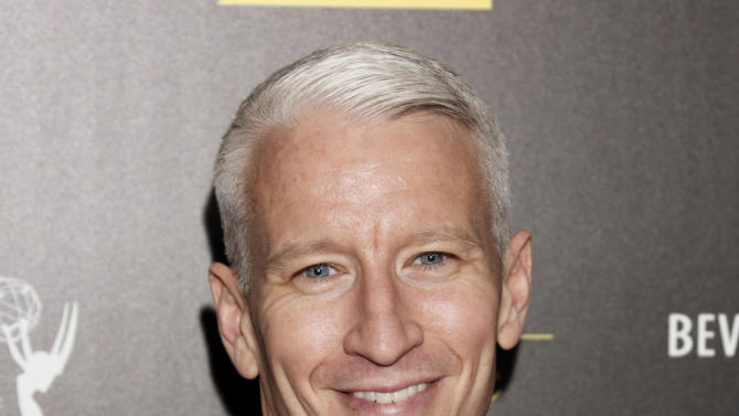 """FILE - This June 23, 2012 file photo shows CNN's Anderson Cooper arrives at the 39th Annual Daytime Emmy Awards at the Beverly Hilton Hotel in Beverly Hills, Calif. Cooper came out in a letter online, saying """"the fact is, I'm gay."""" He said Monday, July 2, in a note to the Daily Beast's Andrew Sullivan that he had kept his sexual orientation private for personal and professional reasons, but came to think that remaining silent had given some people an impression that he was ashamed. (Photo by Todd Williamson/Invision/AP, file)"""