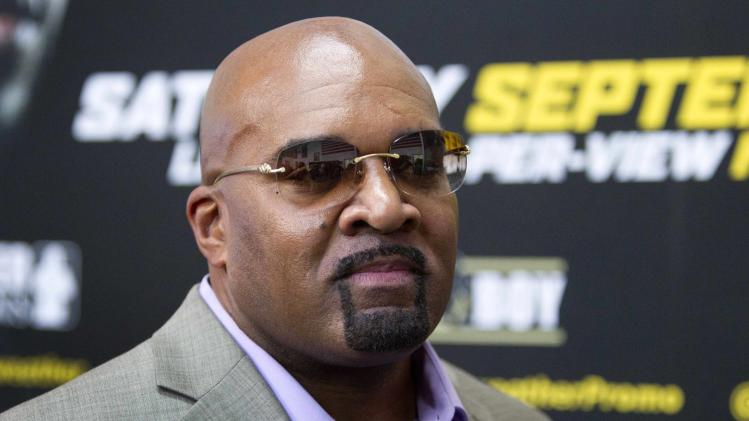 Leonard Ellerbe, CEO of Mayweather Promotions, watches as WBC/WBA welterweight champion Floyd Mayweather Jr. of the U.S. talks with reporters during a media day at the Mayweather Boxing Club in Las Vegas