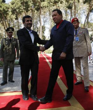 Iranian President Mahmoud Ahmadinejad, left, shakes hands with his Venezuelan counterpart Hugo Chavez, during an official welcoming ceremony for him, in Tehran, Iran, Tuesday, Oct. 19, 2010. Venezuelan President Hugo Chavez is holding talks with Iranian leaders expected to focus on boosting cooperation between the countries' oil, gas and petrochemical industries. (AP Photo/Vahid Salemi)