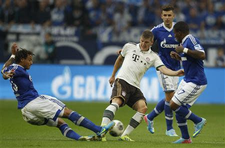 Schalke 04's Jones, Szalai and Farfan challenge Bayern Munich's Schweinsteiger during the German first division Bundesliga soccer match in Gelsenkirchen