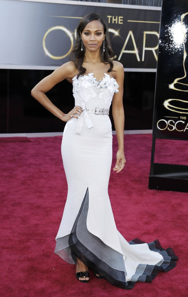 "Actress Zoe Saldana from ""Star Trek"" wearing a belted Alexis Mabille gown arrives at the 85th Academy Awards in Hollywood"