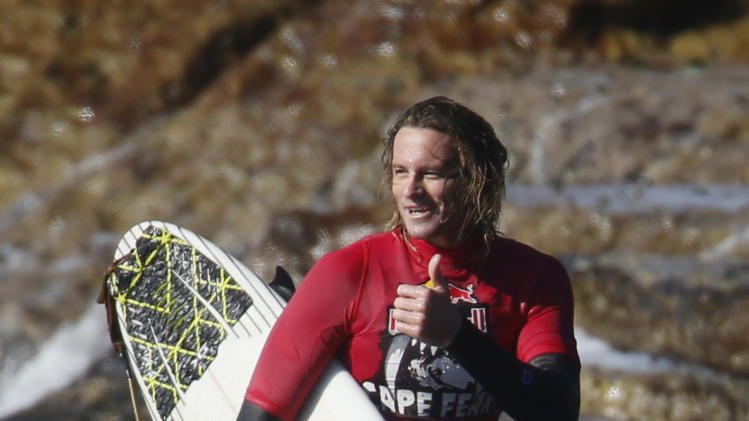 Australia's Laurie Towner gives a thumbs-up at the inaugural Red Bull Cape Fear invitational surfing tournament off the shores of southern Sydney