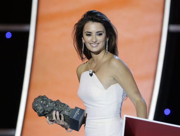 "FILE - Spanish actress Penelope Cruz during the presentation of the Goya 2010 film awards in Madrid, Spain, in this file photo dated Sunday Feb. 14, 2010. In a statement released Sunday Sept. 9, 2012 Oscar-winning actress Cruz denied saying she would create hundreds of jobs in Spain by making at least two films a year there and slammed an Italian newspaper for allegedly manipulating her words, saying the financial crisis engulfing Spain was too serious an issue ""to allow my words to be misinterpreted or manipulated for the sake of manufacturing frivolous headlines.""(AP Photo/Paul White, File)"