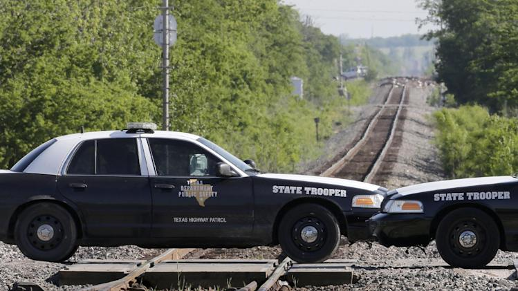 A state trooper mans a roadblock Saturday, April 20, 2013, three days after an explosion at a fertilizer plant in West, Texas. The massive explosion at the West Fertilizer Co. Wednesday night killed at least 14 people and injured more than 160. (AP Photo/Charlie Riedel)
