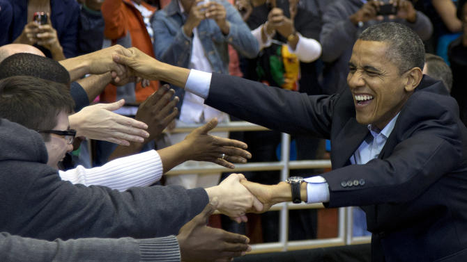 President Barack Obama greets people as he arrives at a campaign event at the Fifth Third Arena on the University of Cincinnati campus, Sunday, Nov. 4, 2012, in Cincinnati. (AP Photo/Carolyn Kaster)