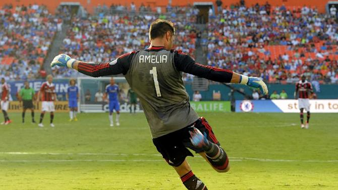 COMMERCIAL IMAGE - In this photograph taken by AP Images for Herbalife, A.C. Milan goalie Marco Amelia puts the ball in play against Chelsea FC at the Herbalife World Football Challenge, Saturday, July 28, 2012, at Sun Life Stadium in Miami. (Brian Blanco / AP Images for Herbalife)