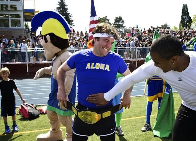 Aloha teacher Scott Baker and Thomas Tyner joke around after their match race — The Oregonian