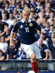 Steven Naismith faces a nervous wait to see if he will miss Scotland's game with Wales