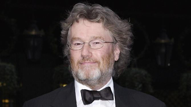 "FILE - An April 7, 2004 photo from files showing author Iain Banks at a function in London. Iain Banks' publisher says that the Scottish writer has died after falling ill with cancer. Banks was known for his general fiction and science fiction, the latter written under the name Iain M. Banks. Banks published his first novel ""The Wasp Factory"" in 1984. His first science fiction novel, ""Consider Phlebas,"" was published in 1987. (AP Photo/PA,Yui Mok, File)  UNITED KINGDOM OUT  NO SALES  NO ARCHIVE"