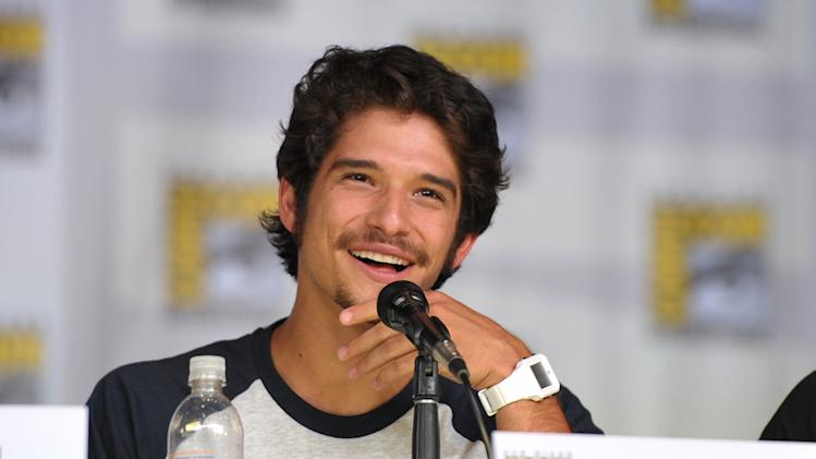 "IMAGE DISTRIBUTED FOR MTV - Tyler Posey speaks at the ""Teen Wolf"" panel at the San Diego Convention Center on Day 2 of Comic-Con International on Thursday, July 18, 2013, in San Diego, Calif. (Photo by John Shearer/Invision for MTV/AP)"