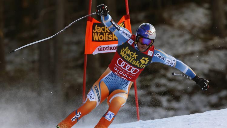 Svindal of Norway clears a gate during the men's World Cup Downhill skiing race in Val Gardena