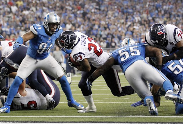 Houston Texans running back Arian Foster breaks away from Detroit Lions defensive end Lawrence Jackson (94) and linebacker Stephen Tulloch (55) for a touchdown during the fourth quarter of an NFL foot