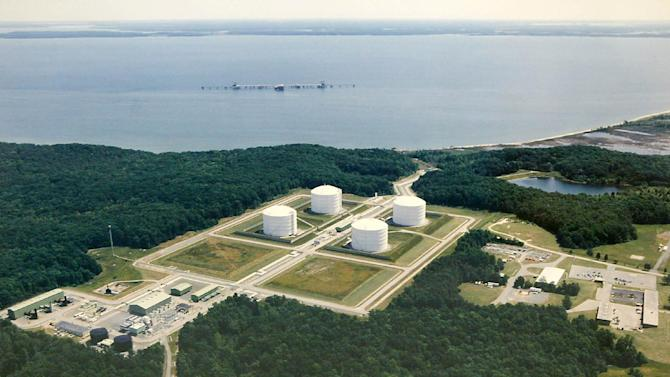 FILE - This undated aerial file photo provided by Dominion shows the Dominion Liquefied Natural Gas (LGN) facility in Cove Point, Md. A domestic natural gas boom already has lowered U.S. energy prices while stoking fears of environmental disaster. Now U.S. producers are poised to ship vast quantities of gas overseas as energy companies seek permits for proposed export projects that could set off a renewed frenzy of fracking. Expanded More than 20 projects to export LNG are under review by the Energy Department. (AP Photo/Dominion)