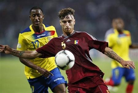 Venezuela's Amorebieta fight for the ball with Ecuador's Ayovi during their 2014 World Cup qualifying soccer match in Puerto La Cruz,