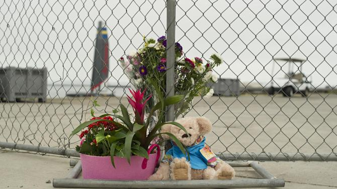 """Flowers and a teddy bear form a memorial to British sailor Andrew """"Bart"""" Simpson at Artemis Racing's Alameda, Calif., headquarters on Friday, May 10, 2013.  Simpson, the team's strategist, died Thursday when Artemis' 72-foot-long catamaran capsized during America's Cup training trapping him underwater.  (AP Photo/Noah Berger)"""