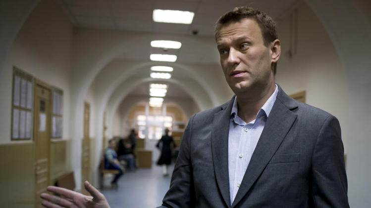 In this photo taken Wedensday, March 13, 2013, Russian opposition activist Alexei Navalny speaks to journalists outside a courtroom in Moscow, after his appeal against the country's top investigative agency was rejected. Alexei Navalny, a leading anti-corruption activist embroiled in four separate legal battles with the Investigative Committee, had filed a complaint asking the Investigative Committee to begin proceedings against its chairman, Alexander Bastrykin, for his threat to murder a journalist in June last year.(AP Photo/Alexander Zemlianichenko)
