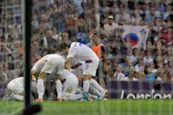 Korea&#39;s forward Park Chuyoung (C) celebrates with teammates after scoring the first goal against Japan during their London 2012 Olympic Games football bronze medal match, on August 10, at the Millenium stadium in Cardiff. S.Korea won 2-0