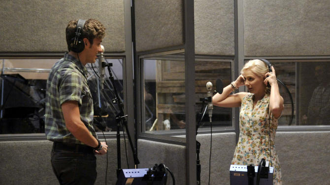 "This Aug. 20, 2012 file photo shows Sam Palladio, who portrays Gunnar Scott, left, and Clare Bowen, who portrays Scarlett O' Connor, rehearse a scene on the set of ABC's ""Nashville"" in Nashville, Tenn. The music of ""Nashville"" has been as much a star on the hourlong ABC drama as Connie Britton, Hayden Panettiere, Charles Esten, Jonathan Jackson, Bowen and Palladio. Each actor sings their own part, and so far fans seem to be responding, buying more than 800,000 digital singles.  (Photo by Donn Jones/Invision, file)"