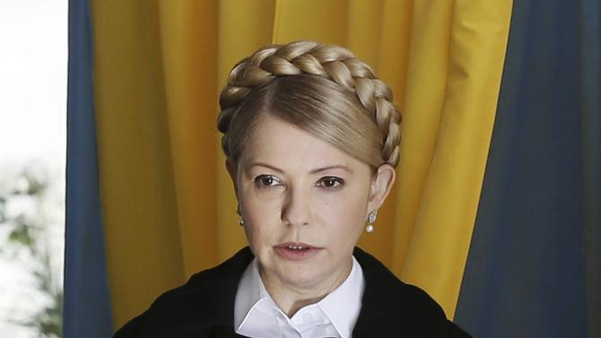 Former Ukrainian Prime Minister Yulia Tymoshenko, leader of Batkivshchyna (Fatherland) party, holds a ballot at a polling station during a parliamentary election in Dnipropetrovsk