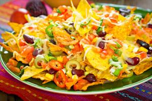 Everyone thinks they love nachos, but in reality they're one of the most flawed foods in existence. Sure, they look nice, but a plate of nachos is nearly impossible to eat: soggy chips on top are covered in cheese and other gloopy toppings, while the ones underneath remain topping-free. One chip can have nothing but sour cream on it; another could pull half the cheese off with it. Nothing but empty calories ruined by poor topping distribution.