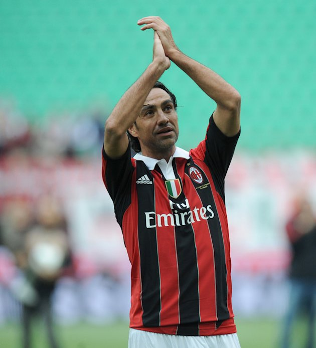(From C) AC Milan's Alessandro Nesta Applauds AFP/Getty Images