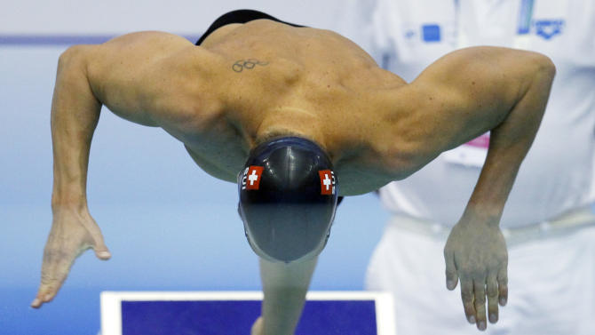 Dominik Meichtry from Switzerland starts for a Men's 200m Freestyle heat at the European Short Course Swimming Championships in Szczecin, Poland, Sunday, Dec. 11, 2011. (AP Photo/Michael Sohn)