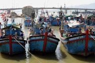Fishing boats are seen anchored at a port in the central coastal resort city of Nha Trang, Vietnam. Australian officials are seeing a rising number of Asian fish imports containing banned antibiotics, a report said Wednesday