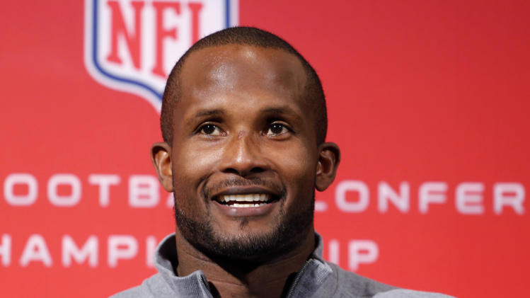 FILE - In this Jan. 15, 2014 file photo, Denver Broncos cornerback Champ Bailey smiles during a news conference at the NFL Denver Broncos football training facility in Englewood, Colo. The Broncos are scheduled to play the Seattle Seahawks in the NFL Super Bowl on Feb. 2, in East Ruterford, N.J. It will be Bailey's first Super Bowl. (AP Photo/Ed Andrieski, File)