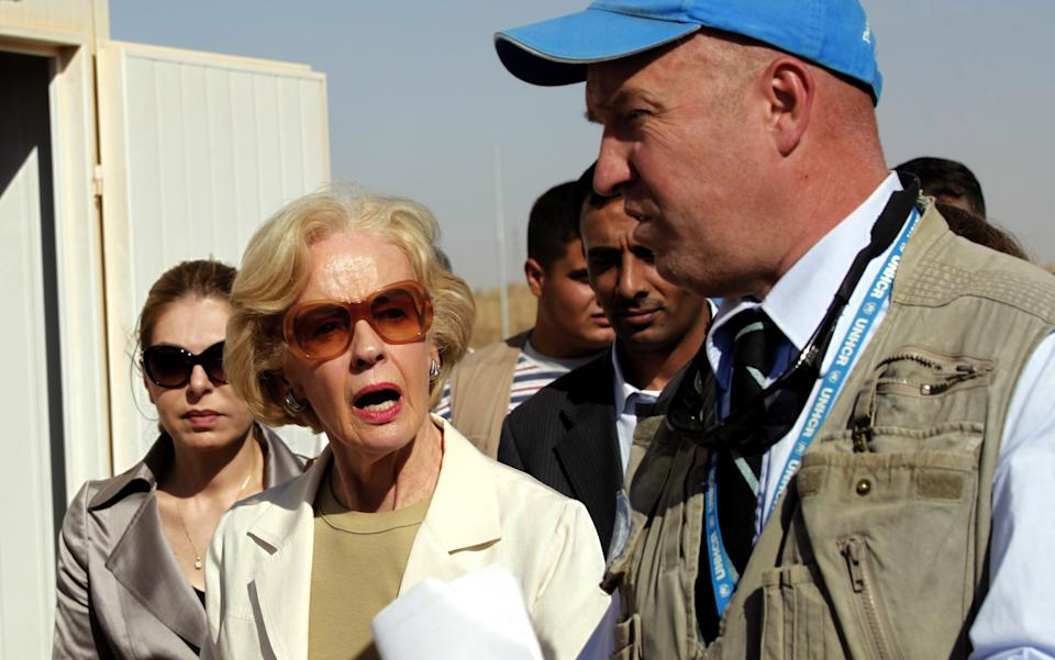 Quentin Bryce, the Australian Governor-General, left, tours the Zaatari Syrian Refugee Camp, along with UNHCR representative to Jordan, Andrew Harper, right, in Mafraq, Jordan, Sunday, Sept. 2, 2012. Bryce told the press that Australia has contributed 20 million in funds to support the refugees. (AP photo/Mohammad Hannon)