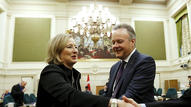 Bank of Canada Governor Poloz and Senior Deputy Governor Wilkins greet committee members while waiting to testify on Parliament Hill in Ottawa