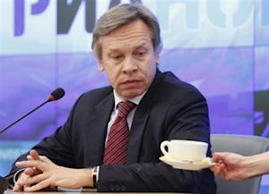 Pushkov, Chairman of the Russian State Duma Committee on International Affairs, attends a news conference in Moscow