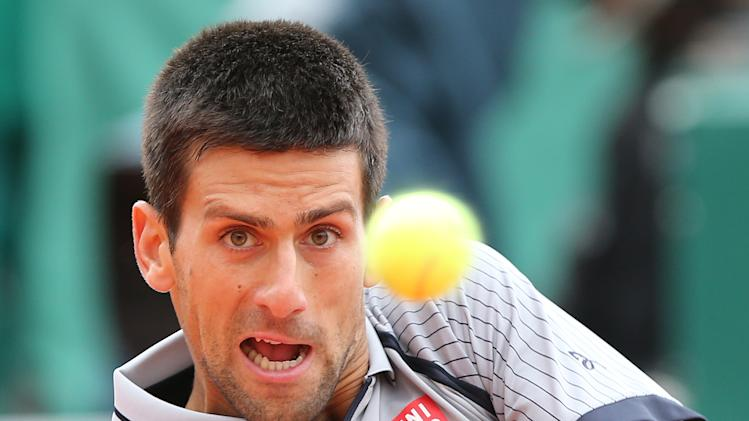 Novak Djokovic of Serbia plays a return to Fabio Fognini of Italy during their semifinal match of the Monte Carlo Tennis Masters tournament in Monaco, Saturday, April 20, 2013. (AP Photo/Claude Paris)