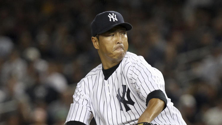 New York Yankees' Hiroki Kuroda pitches during the first inning of a baseball game against the Boston Red Sox, Sunday, Aug. 19, 2012, at Yankee Stadium in New York. (AP Photo/Seth Wenig)