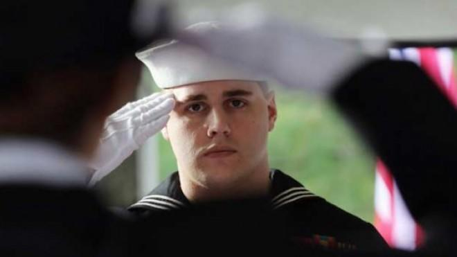 A U.S. Navy honor guard salutes: The jobless rate for post-9/11 vets was at 10.8 percent in December.