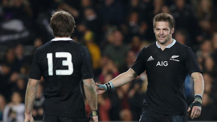 McCaw, captain of New Zealand's All Blacks, congratulates teammate Smith after defeating the Australia's Wallabies during their second Bledisloe Cup rugby championship match at Eden Park in Auckland