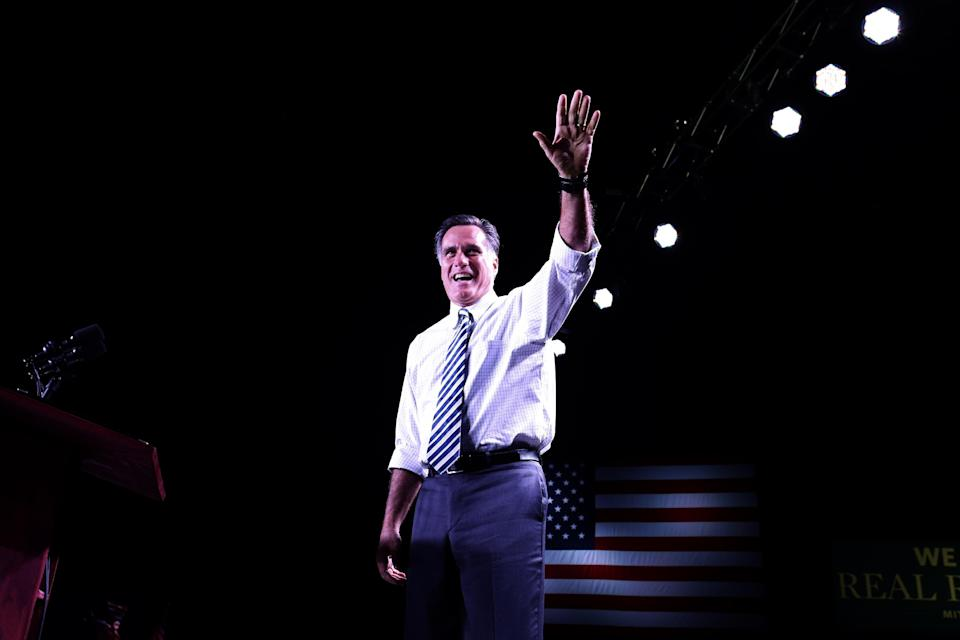 Republican presidential candidate, former Massachusetts Gov. Mitt Romney takes the stage at an election campaign rally at the Reno Event Center in Reno, Nev., Wednesday, Oct. 24, 2012. (AP Photo/Charles Dharapak)