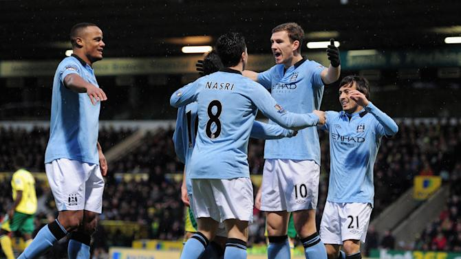 NORWICH, ENGLAND - DECEMBER 29: Edin Dzeko of Manchester City celebrates scoring his team's second goal with team mates during the Barclays Premier League match between Norwich City and Manchester City at Carrow Road on December 29, 2012 in Norwich, England. (Photo by Jamie McDonald/Getty Images)