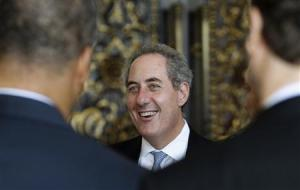 U.S. Trade Representative Michael Froman talks to delegates as he waits for the conclusion and closing ceremony of the ninth WTO Ministerial Conference in Nusa Dua