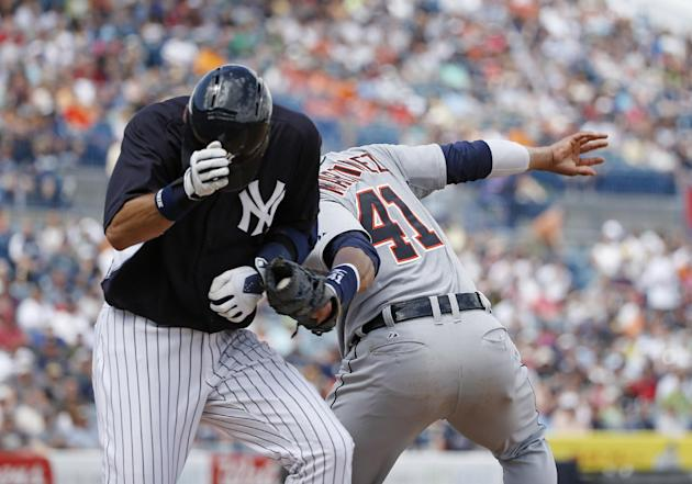 Detroit Tigers Victor Martinez (41) tags New York Yankees Derek Jeter out at first in the sixth inning of a spring exhibition baseball game in Tampa, Fla., Wednesday, March 12, 2014