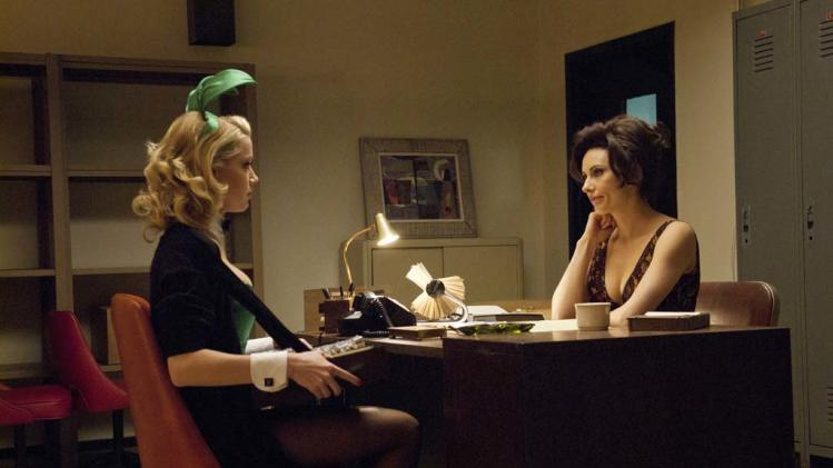 "Amber Heard as Maureen and Laura Benanti as Carol Lynne in ""The Playboy Club."""