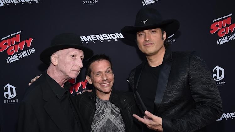 "Writer/director Frank Miller, and from left, Carl Thiel and director Robert Rodriguez arrive at the ""Sin City: A Dame to Kill For"" premiere presented by Dimension Films in partnership with Time Warner Cable, Dodge and DeLeon Tequila at TCL Chinese Theatre on Tuesday, August 19, 2014, in Los Angeles. (Photo by John Shearer/Invision for The Weinstein Company/AP Images)"