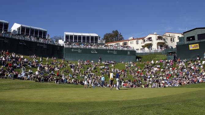 The threesome of Bill Haas, Matt Kuchar and Ryan Moore take to the 18th green in the third round of the Northern Trust Open golf tournament at Riviera Country Club in the Pacific Palisades area of Los Angeles, Saturday, Feb. 16, 2013. (AP Photo/Reed Saxon)