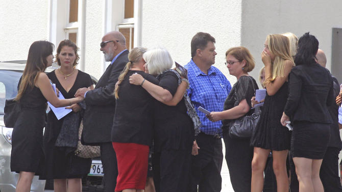 Barry Steenkamp, third left, the father of Reeva Steenkamp, greets people as he and others attend her funeral,  in Port Elizabeth, South Africa, Tuesday, Feb. 19, 2013.Olympic athlete Oscar Pistorius is charged with the premeditated murder of Reeva Steenkamp on Valentine's Day. The defense lawyer says it was an accidental shooting. (AP Photo/Schalk van Zuydam)